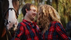 Loving couple on a walk with horses Stock Footage