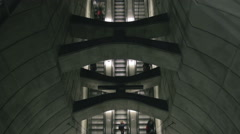 Topview timelapse of symmetrical escalators, one is in regular speed Stock Footage