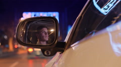 Reflection of driver on side mirror of vehicle Stock Footage