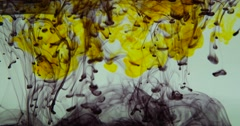 Black and Yellow Ink in Water Stock Footage