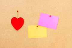 Valentine's day heart and empty cards on wooden background - stock photo