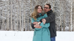 Happy young couple walking in a winter park. Stock Footage
