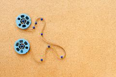 Two little movie reel connected with filmstrip path Stock Photos
