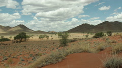 Timelapse of clouds and shadows in valley of Tiras Mountains, Namibia Stock Footage