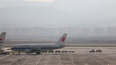 Airplane on runway, ground servicing Stock Footage