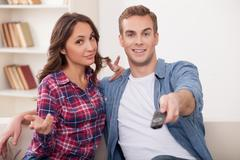 Cheerful boyfriend and girlfriend are entertaining themselves Stock Photos