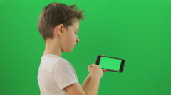 Kid with smartphone device, Green Screen Stock Footage