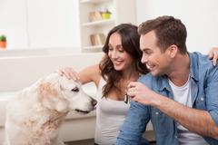 Attractive husband and wife with pretty animal Stock Photos