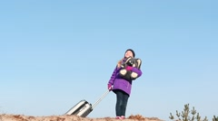 Little girl in winter clothes with toy and trunk outdoors slow motion Stock Footage