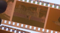 4K 35mm Film Stripes Being Looked at on Light Table Stock Footage