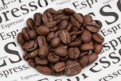 Coffee beans on a saucer - stock photo