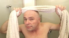 Bald man with towel. - stock footage