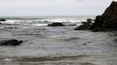 Waves Hitting Rock Off Shore On Overcast Day Stock Footage