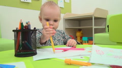 Little baby plays with pencils Stock Footage