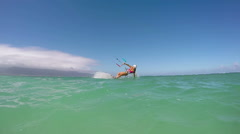 Woman Kite Surfing In Santa Claus Hat - stock footage