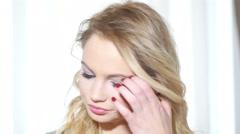 Sad girl close up portrait - beautiful blonde - stock footage