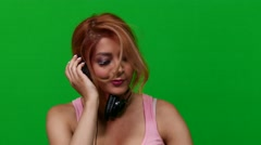 Woman DJing on Green Screen Stock Footage