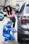Woman in Auto Repair Shop Stock Photos