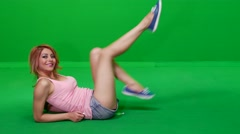 Woman Doing Bike Leg Exercises on Green Screen Stock Footage