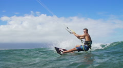 Man Kite Surfing In Ocean on Summer Day Doing Extreme Trick - stock footage