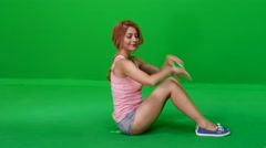 Woman Doing Situps on Green Screen Stock Footage