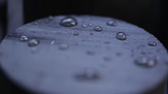 Water Drops on Black Rubber Surface Stock Footage