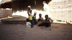Africa kids posing to camera in native village Stock Footage