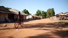 Africa kids riding bike Stock Footage