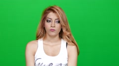 Woman Looking Awkward and Indecisive on Green Screen - stock footage