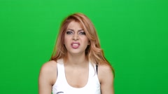 Woman Looking Angry on Green Screen Stock Footage