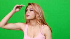 Woman Looking Far Far Away on Green Screen - stock footage