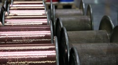 Coils of copper wire industry in the middle of empty coils, slider shot Stock Footage