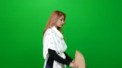 Woman Putting on a Hat on Green Screen Stock Footage