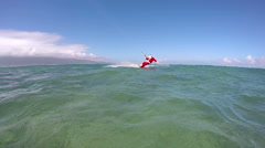Slow Motion Extreme Santa Kite Surfing In Ocean - stock footage