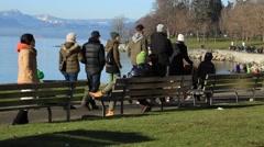 Families walking along sea wall, Vancouver - stock footage