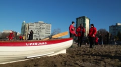 Lifeguards on duty, sunny beach, Vancouver Stock Footage