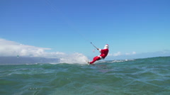 Slow Motion Extreme Santa Claus Kite Surfing In Ocean - stock footage