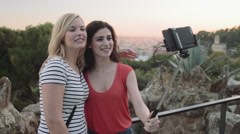 Young adult women taking picture on mobile phone in Barcelona Stock Footage
