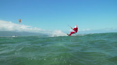 Slow Motion Extreme Santa Kite Surfing In Ocean Stock Footage