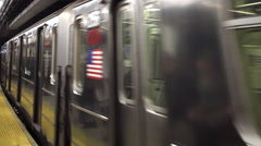 6 train pulling into Astor Place and 8th street NYU station platform in NYC 4K Stock Footage