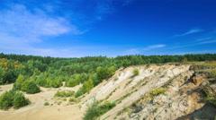 Timelapse of sandhills and pine forest under blue sky. Rural landscape. - stock footage