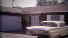 1965: White classic car parked in driveway of modest suburban home. SAN DIEGO, - stock footage
