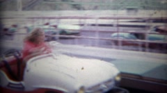 1965: Retro style bumper cars pulling out into the melee carnage crash area. SAN Stock Footage