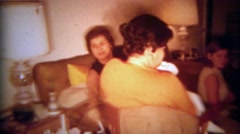 1965: Family playing poker cards crowding together on living room floor.  SAN Stock Footage
