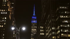Cars and bicyclists in 8th ave - zoom out Empire State Building night 4K NYC Stock Footage
