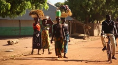 Africa people in native village walking in the street Stock Footage