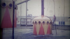 1965: Odd underwater pod amusement park ride sinks and floats thrill seekers. Stock Footage