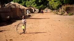 Africa village kid with old tyre Stock Footage