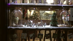 holiday dispay in creperie - Christmas tree and pastries in glass, 4K - stock footage