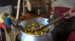 Pulling a yellow silk from cocoons silkworm, Thai silk Stock Footage